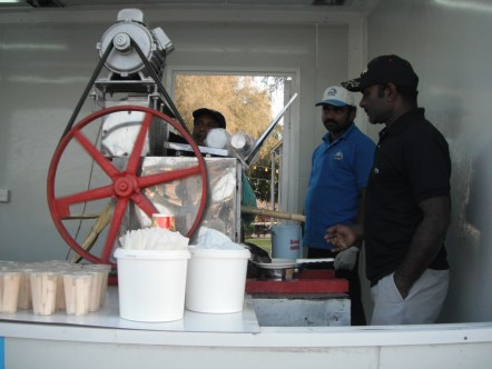 Fresh sugarcane juice made in front of you