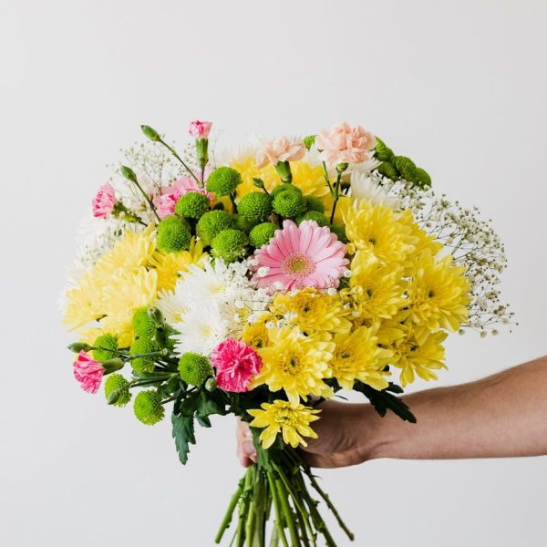 crop man with big bouquet in hand