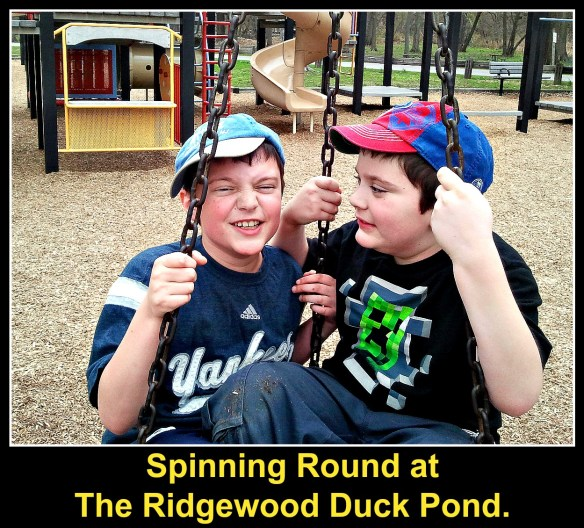 Boys on the tire at the Ridgewood Duck Pond