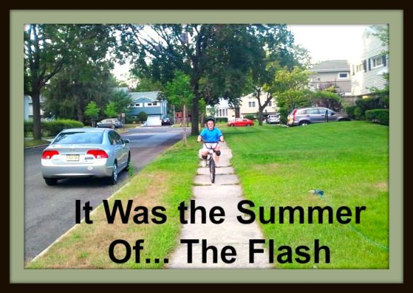 The Summer of... The Flash: SJ riding a bike.