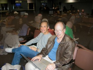 photo of Joe La Barbera and Tom Warrington in airport terminal waiting to Catch a Plane for a New Zealand Tour