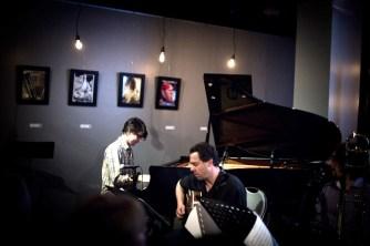 photo of Josh Nelson playing piano and Larry Koonse playing guitar