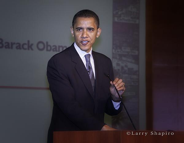 Barack Obama speaking at a podium