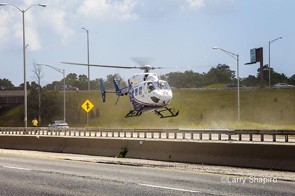 Lifestar Chicago BK117 medical helicopter landing on a highway