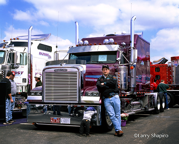 purple Freightliner FLD tractor with the owner/operator