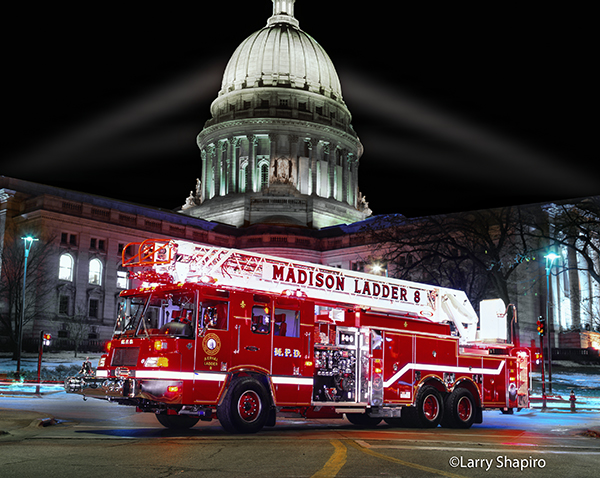 fire truck at night with a state capitol building