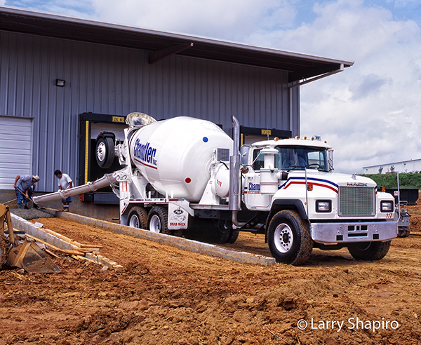 Mack DM cement mixer at work
