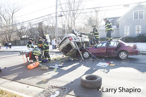 firemen working at crash scene