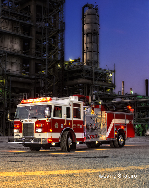 dramatic photo of a fire engine at dusk