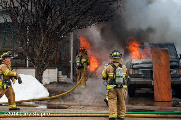 firemen attack a mobile home fire