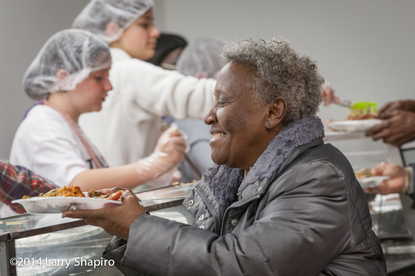 woman receiving food at a soup kitchen