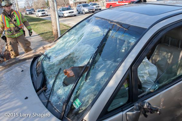 fence posts jut out of a car windshield after a wreck