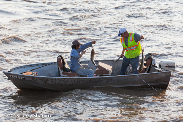Fishermen in a boat on the Des Moines River