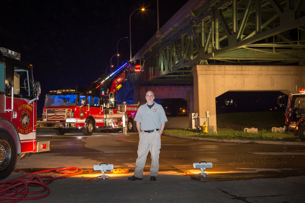 the making of a night photograph with a fire truck