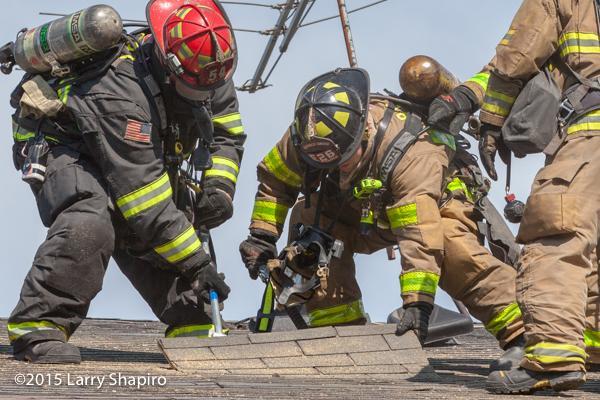 firemen venting a roof