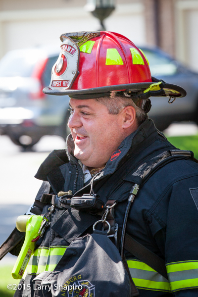 firefighter wearing PPE talking with friends