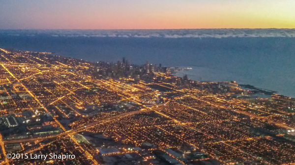 The Chicago skyline and lakefront at dawn from an plane