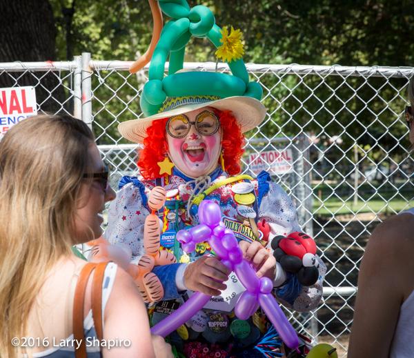 woman as clown making balloon art