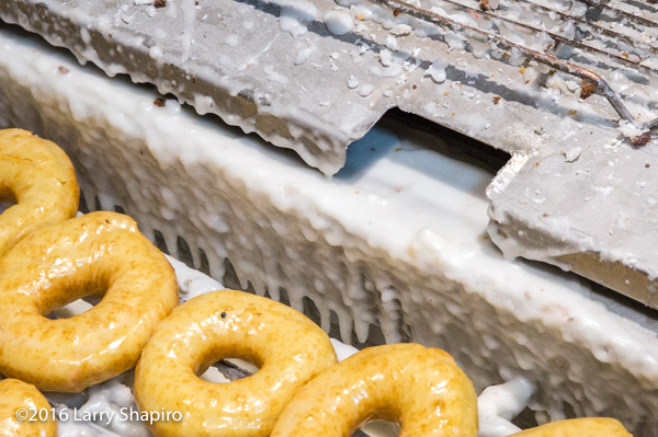 fresh donuts being made