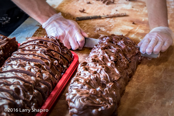 cutting fresh fudge