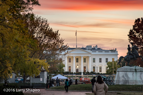 orange sunset behind The White House