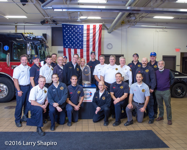 Winnetka Fire Department personnel with the world series trophy