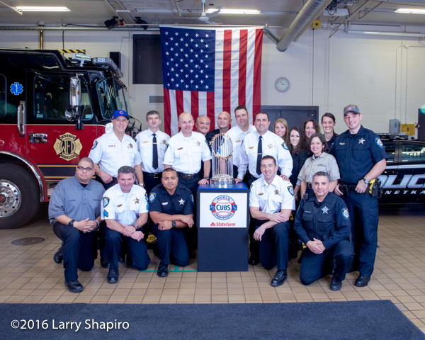 Winnetka Police Department personnel with the world series trophy