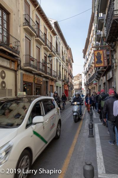 bustling street scene in Granada