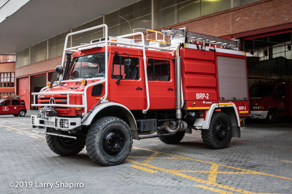 off-road brush fire engine by Rosenbauer on a Unimog chassis with the bomberos de Granada Spain