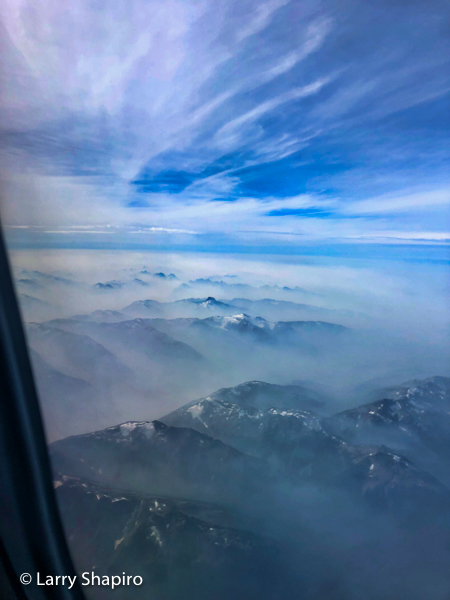 fog and snow capped Mountains of British Columbia seen from an airplane