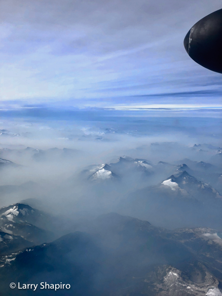 snow capped Mountains of British Columbia seen from a turbo prop airplane