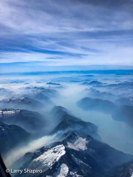 rivers , mist and snow capped Mountains of British Columbia seen from an airplane