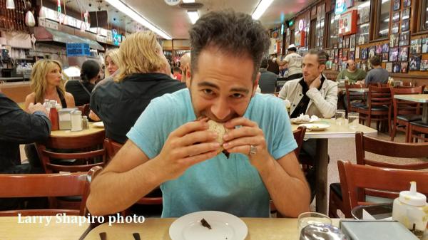 Ben Fink Shapiro eating pastrami at Katz's Deli in manhattan