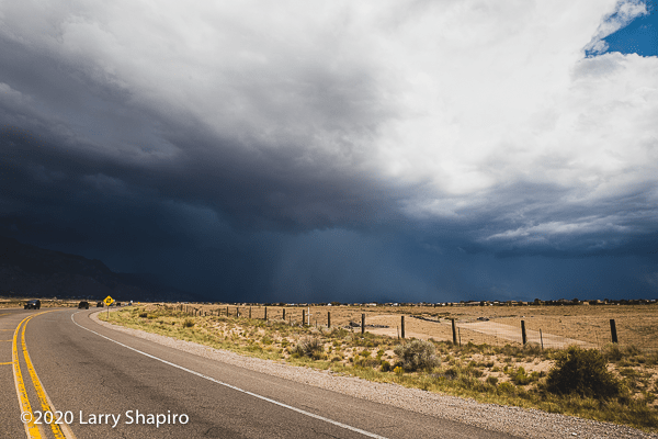 heavy rain storm approaches New Mexico highway
