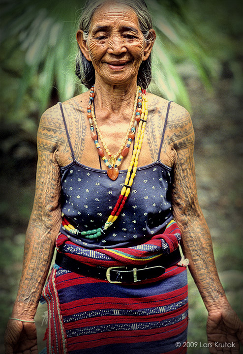 An old lady with many tattoos