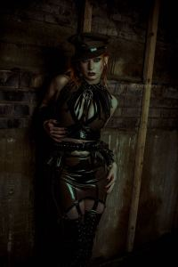 redheaded woman wearing Antidote London Latex. Founder Jennifer Brawls interviewed by erotic marketing agency Lascivious Marketing [credit: Anouk Dyonne Photography]