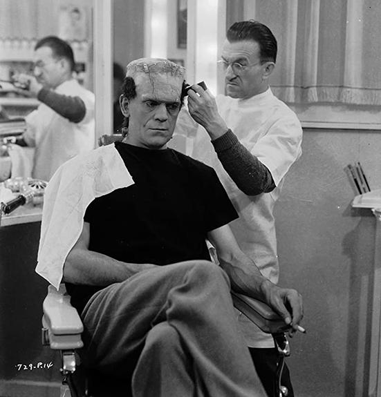 Jack Pierce maquillando a Boris Karloff para La novia de Frankenstein.