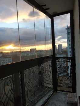 безрамное остекление балкона в санкт-петербурге
