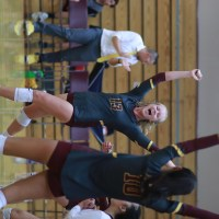 Girls Volleyball Spikes into the 2019