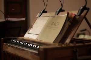 brown booklet in a brown wooden piano close up photography