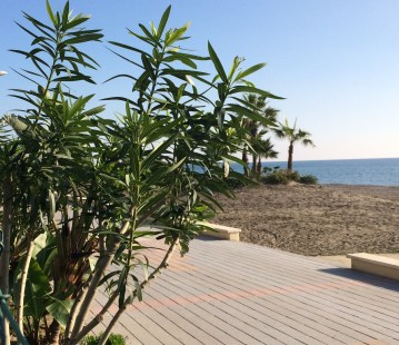 The promenade and beach with ramped access directly outside apartment complex.