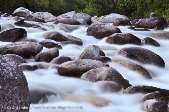 Water washes over and besides the rounded boulders in the Little Su. www.cecilsandersphotography.com