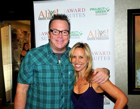 Tom Arnold and Stacy Broff happily showing support in going green.