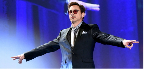Robert Downey Jr. arriving on the stage before presenting the Icon Award to Co-star Robert Duvall