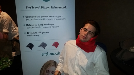 Tyler Emery demonstrating the support of the Trtl Pillow!