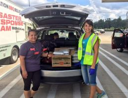 Helping Operation BBQ Relief disperse food to those in need