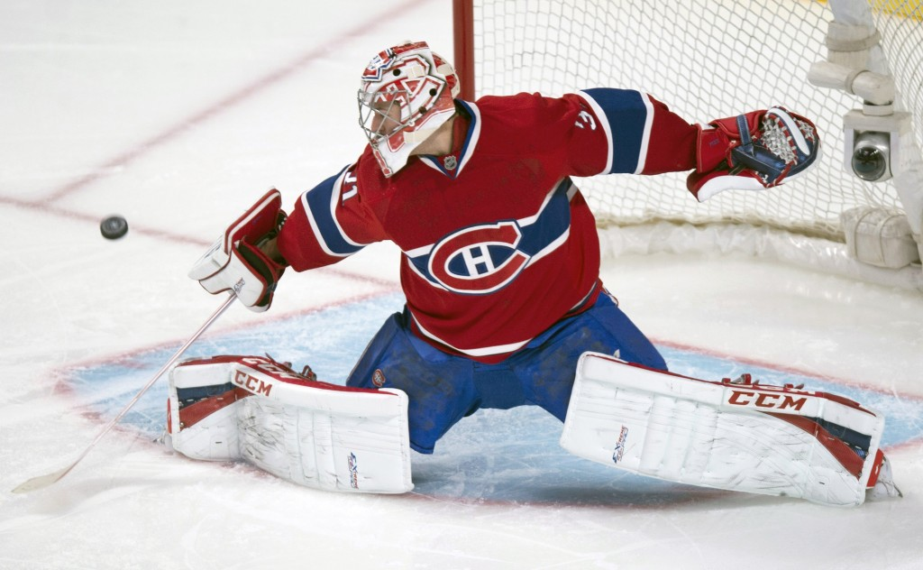 Montreal Canadiens goalie Carey Price deflects a shot during first period of an NHL hockey game against the New York Islanders, Sunday, Nov. 10, 2013, in Montreal. (AP Photo/The Canadian Press, Paul Chiasson)