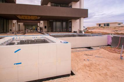 Infinity Edge Custom Swimming Pool Design at Summit Club Private Golf Course