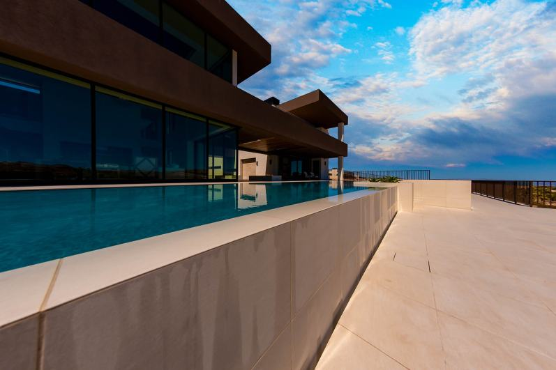 Infinity Edge Swimming Pool Feature View From Lower Deck - Clarity Pool Service