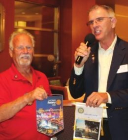 Bob Werner exchanges flags with our visiting Rotarian.